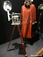 1920s Coat with Old Fashioned Tripod Camera