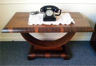 art deco coffee table with Bakelite phone