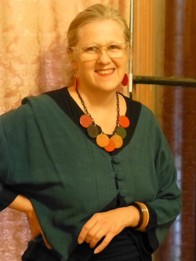 Lesley Postle, author of Decolish.com wearing Bakelite Jewelry