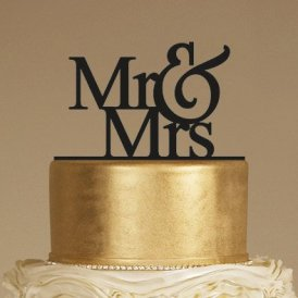 Mr & Mrs Wedding Cake Topper on a Gold Cake