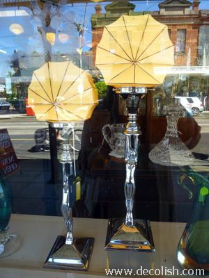 Naked lady art deco lamps in shop window