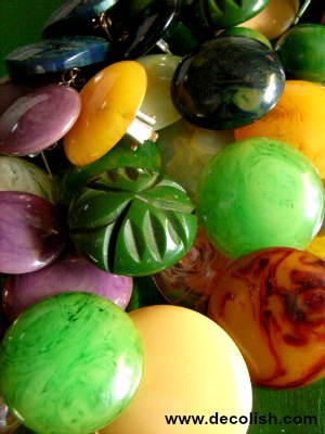 Large colourful pile of Bakelite earrings