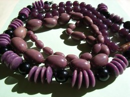 Several Purple and Black Bakelite Bead Necklaces