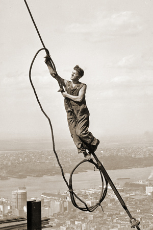Construction Worker Dangling from a Cable above New York City