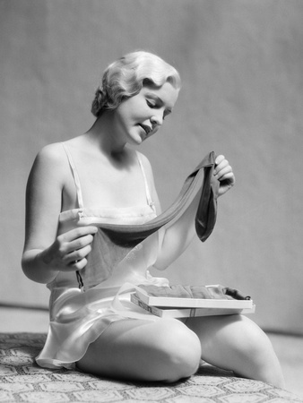 Lady in 1930s Silk Teddy Opening Stockings