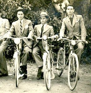 1930s Mens Fashion. Three men on bicycles