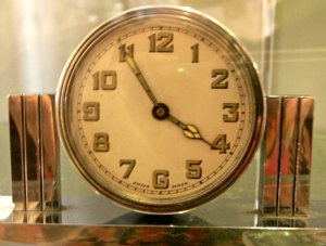 Chrome clock with deco pillars on either side