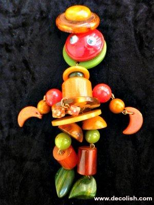 Bakelite Crib Toy Brooch