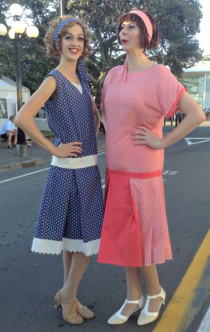 Girls wearing Blue and red 1920s style dresses with Mary Janes