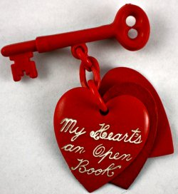 Red Valentine Heart Pin Dangling from a Key